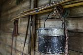 stock photo of fishing rod  - fishing gear and fishing rods bowler in the village on the wall of the shed - JPG