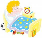 stock photo of stretch  - Little boy waking up and stretching in his bed at home - JPG