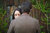 picture of sweethearts  - Peaceful woman with closed eyes standing close to her sweetheart - JPG