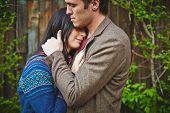 pic of amor  - Amorous couple in casualwear cuddling outside - JPG