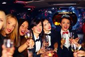 picture of hen party  - group of happy elegant women clinking glasses in limousine hen party - JPG