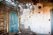 picture of abandoned house  - Paint peels from an abandoned farm house room  - JPG