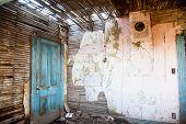 foto of farm-house  - Paint peels from an abandoned farm house room  - JPG