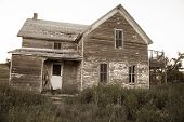 picture of prairie  - An abandoned homestead deteriorates over time in an open prairie  - JPG