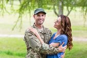 image of reunited  - Handsome soldier reunited with partner on a sunny day - JPG