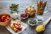 stock photo of pickled vegetables  - Pickled Vegetables On The Wooden Background Close Up - JPG