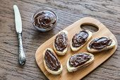 pic of baguette  - Slices Of Baguette With Chocolate Cream On The Wooden Board - JPG