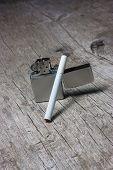 foto of cigarette lighter  - Cigarette with lighter on the wooden table - JPG