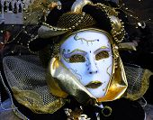 stock photo of carnivale  - a masked woman is dressed for carnivale in veniceitaly - JPG