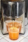 stock photo of juicer  - Juicer for making apple and carrot juice - JPG