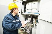 pic of fuse-box  - electrician builder engineer inspector checking data of equipment in fuse box - JPG