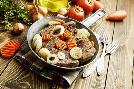 stock photo of liver fry  - Liver fried with carrot and onion in a frying pan - JPG
