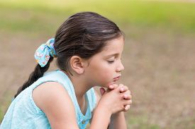 picture of prayer  - Little girl saying his prayers on a sunny day - JPG