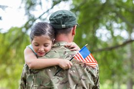image of reunited  - Soldier reunited with his daughter on a sunny day - JPG