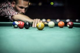 foto of pool ball  - Billiard balls in a green pool table