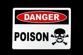 image of skull crossbones  - A poison danger sign against a black background - JPG