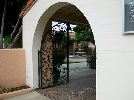 picture of entryway  - Peaceful church patio with archway entryway to the center - JPG