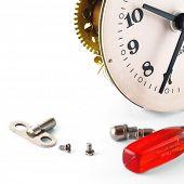 Broken clock with screws over white