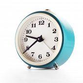 Retro blue clock isolated on white
