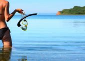 Young woman with diving equipment
