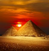 stock photo of the great pyramids  - Pyramids in Giza valley under sunset light - JPG