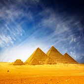 Giza pyramids and blue sky with clouds
