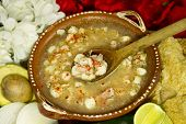 stock photo of mexican food  - Mexican Pozole soup seen from the top made with white large corn pork chicken oregano and chili - JPG