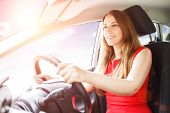 Постер, плакат: Young Lady Driving Car Driving School Background