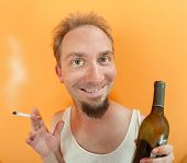 Man With Alcohol And Cigarette