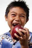 Boy With Missing Front Teeth About To Bite An Apple