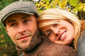 stock photo of love couple  - Young couple in love and having some autumn fun - JPG