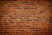 stock photo of brick block  - Weathered stained old brick wall background - JPG