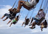 picture of ferris-wheel  - People in the spinner in the amusement park - JPG