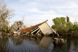 image of katrina  - This fishing camp collapsed when the storm surge of Hurricane Katrina flooded the Manchac Swamp off Lake Maurepas just north of New Orleans - JPG