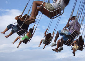 image of ferris-wheel  - People in the spinner in the amusement park - JPG