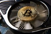 Bitcoin And Video Card, Close-up. Cryptocurrency Mining Concept With Golden Bitcoins. Bitcoin Mining poster