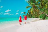 Happy Loving Couple Walk On Tropical Beach poster