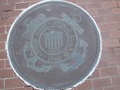 foto of coast guard  - A round emblem embedded in the brick floor of the Louisiana Memorial Plaza in Baton Rouge Louisiana - JPG