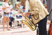 Street musicians play jazz on the town square poster