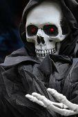 Grim reaper, scary halloween skeleton.