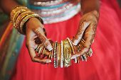 The Tattoo On Hand Of Indian Bride (mehndi Or Henna) With Bracelets And Holding A Lot Of Bracelets ( poster