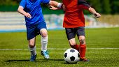 Young Boys Playing Soccer Football Match. Kids Soccer Players In Red And Blue Jersey Shirts. Soccer  poster
