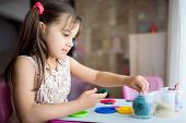 Child Girl Is Playing With Putty At Home poster