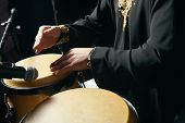 Man Hands Playing Music At Djembe Drums. Musician Playing Congas, Close-up. Rhythm Of Africa, Bongo  poster