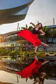 Elegant ballet dancer woman dancing ballet in Singapore city poster