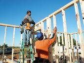 Framing Worker On Ladder