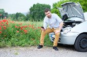 Portrait Of Stressed Man Calling On Cellphone For Service His Breakdown Car poster