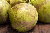 Tropical Fruit On Market - Whole Green Coconut. Coconut Peel Texture. Coco Palm Fruit Closeup Photo. poster