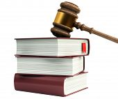 stock photo of magistrate  - Wooden gavel from the court and law books - JPG
