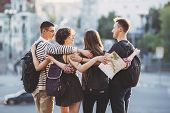 People Travel, Vacation, Holidays, Friendship, City Tour. Friends Travelers With Backpacks Hugging A poster